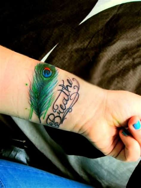 peacock wrist tattoo 57 attractive wrist feather tattoos