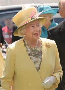 Flowery Dress Majesty the wears summery yellow for epsom derby as the sun