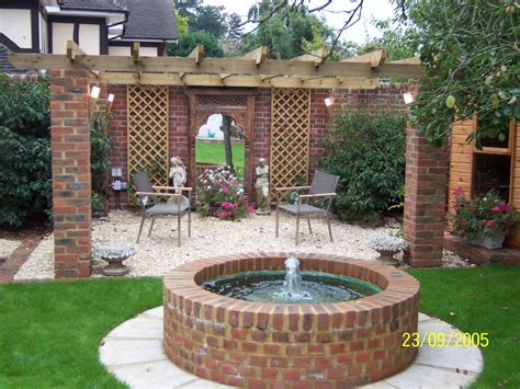 wishing well water feature brick work and stone sittings