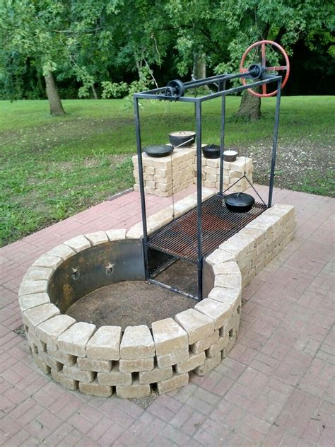 outdoor feuerstelle keyhole pit with adjustable grille cing tips and