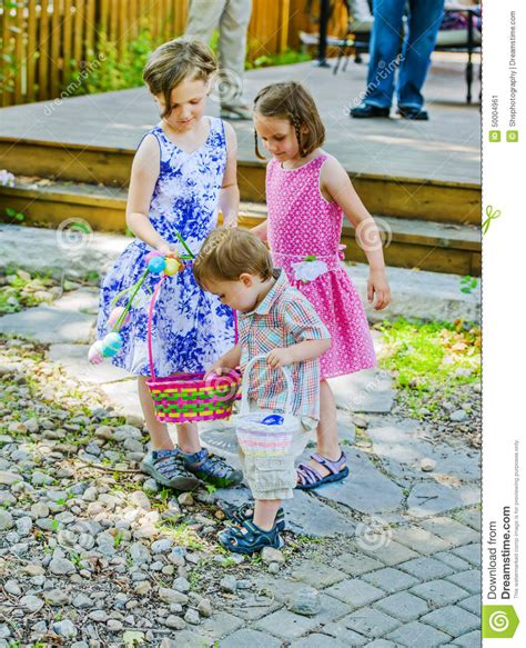 5 Adorable Families Celebrating Easter by Boy Looking At A Easter Eggs Stock