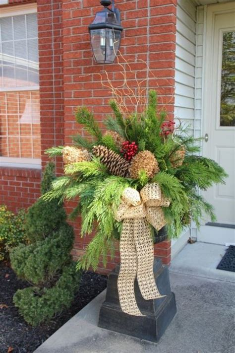 christmas decorating huge stone urns in front of entrance and cozy winter porch decor ideas comfydwelling