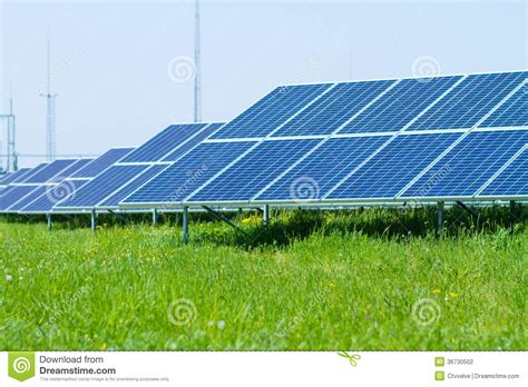 solar panels on green grass stock photography image