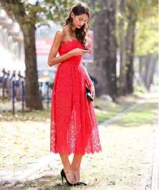 Lace strapless long dress styled with black pumps and matching clutch