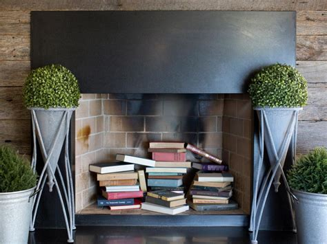 book stacking ideas 8 clever ways to decorate a fireplace hgtv