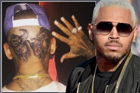 chris brown face tattoo chris brown completes shock new look by unveiling another
