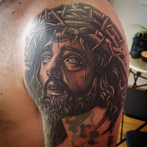 black and grey portrait tattoo dvd black and gray jesus portrait tattoo by body piercing