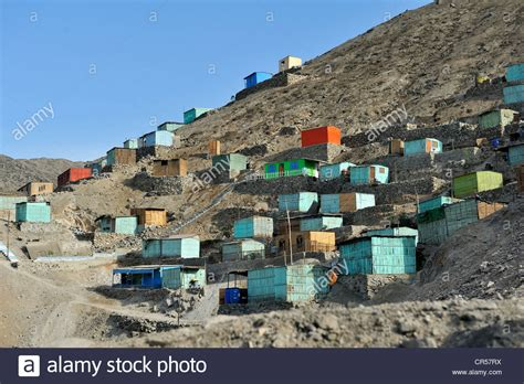 houses built on slopes brightly painted wooden houses built on slopes in