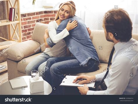 the couch doctor psychologist beautiful young couple sitting on stock photo