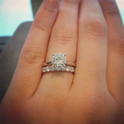 Classic 1.5 carat round solitaire. Paired with an 18kw .55