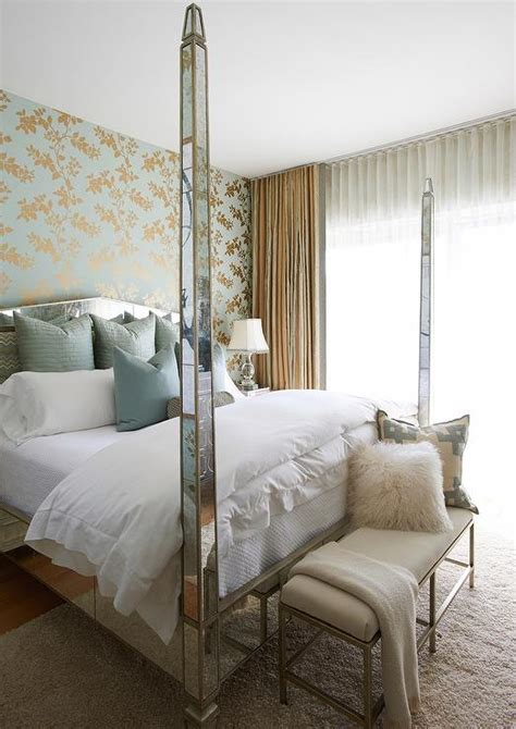 poster wallpaper for bedrooms antiqued mirrored 4 poster bed with blue pillows