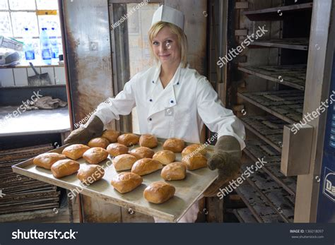 Oven The Baker baker putting tablet buns bread into stock photo 136018097