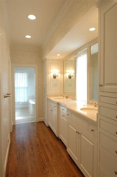 galley style master bathroom. ivory cream damask wallpaper