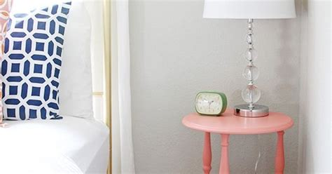 learn about the lrv of sherwin williams repose gray shown in a guest bedroom with coral and