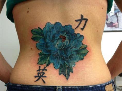 flower tattoo in back flower back tattoo by sakura tattoos