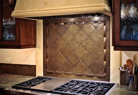 bronze tile backsplash stove traditional kitchen