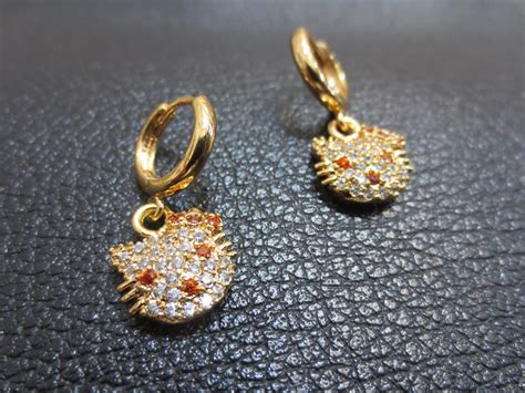 Anting Hello Gold jual titanium jual xuping jual monel anting xuping