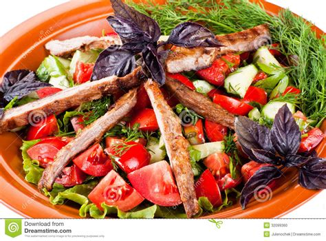 Nstrip Vegethablerovs strips of roast beef and sauteed vegetables salad stock photo image 32099360