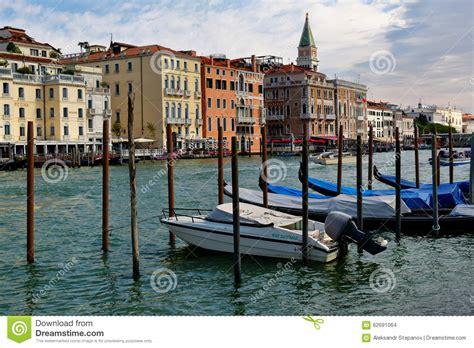 used gondola boat for sale venice italy parked motor boat and gondolas near wooden