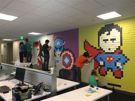 office wall art worker uses 8 024 post it notes to turn boring office walls into superhero murals bored panda
