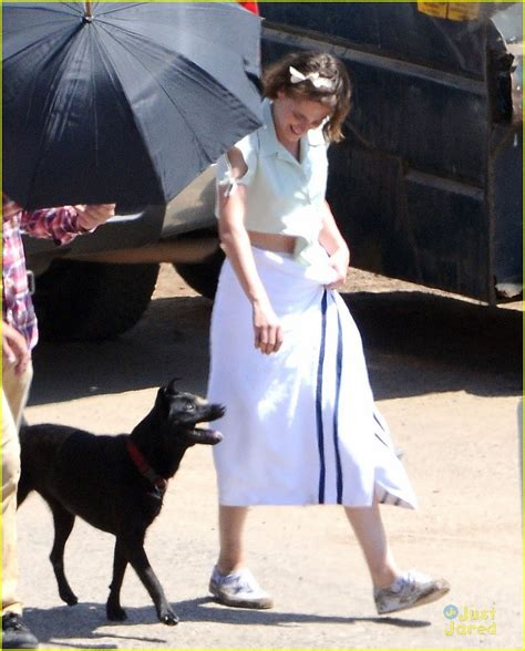 eisenberg dogs kristen stewart plays with a while filming on woody allen with