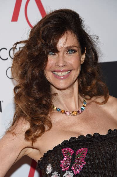 carol alt long haircut angled on the sides and falling carol alt long curls with bangs hair lookbook stylebistro