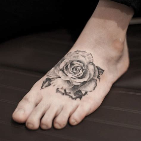 rose tattoo on foot 8 black and white tattoos on foot