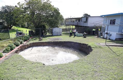 ipswich sinkhole appears in elderly couple s backyard