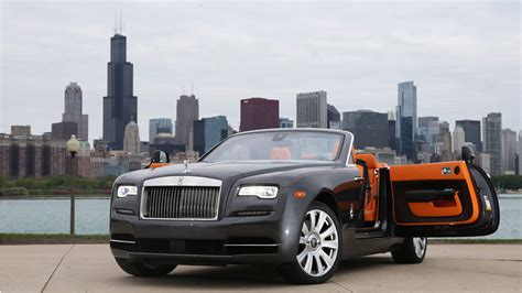 roll royce orange rolls royce drops everything in 400 000 convertible