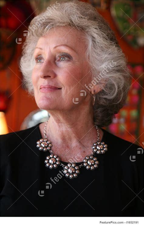 older women wearing jewelry elegant mature woman wearing silver jewelry stock photo