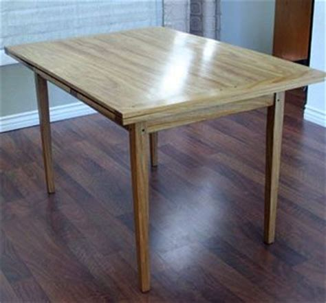 made pull out dining table by woodworks by