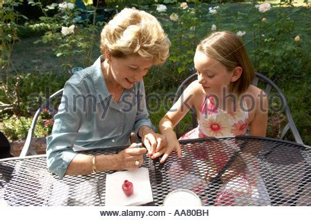nail colors for middle aged women middle aged woman painting her fingernails with red nail