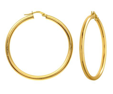 assortment of hoop style gold earring for