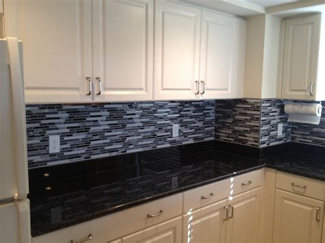 black glass tiles for kitchen backsplashes classic black and white kitchen the glass and linear backsplash really brings it all