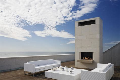 modern coastal house seaside oceanside roof terrace outdoor fireplace furniture summer retreat