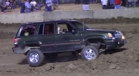 bangshift classic pushing a jeep grand