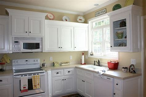 kitchen cabinets painted in white paint for kitchen