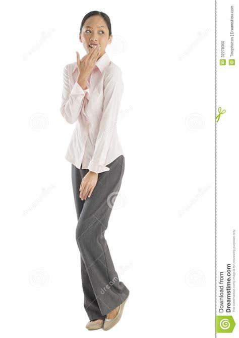 standing sideways surprised mid businesswoman looking sideways stock