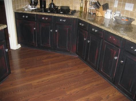 Distressed Black Kitchen Cabinets With Red Color Shadowing Rustic Black Kitchen Cabinets