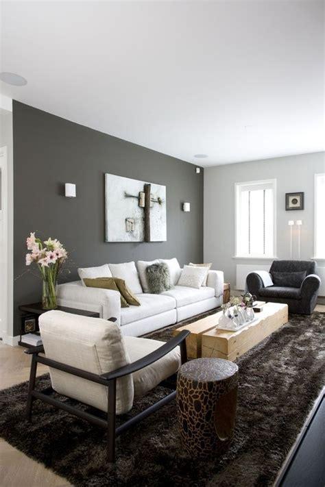 Living room, dark grey wall, light grey couch, shiny
