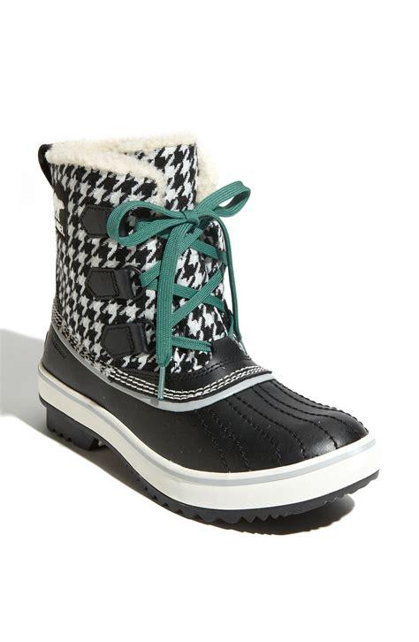 sorel tivoli waterproof boot in black black white
