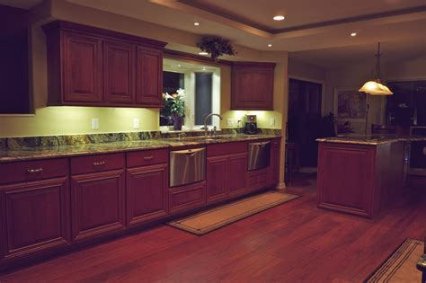 Droped Kitchen Cabinet Lighting With Walnut Cabinet Set Kitchen Countertop Lighting