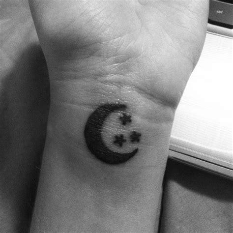 crescent moon tattoo on wrist mine