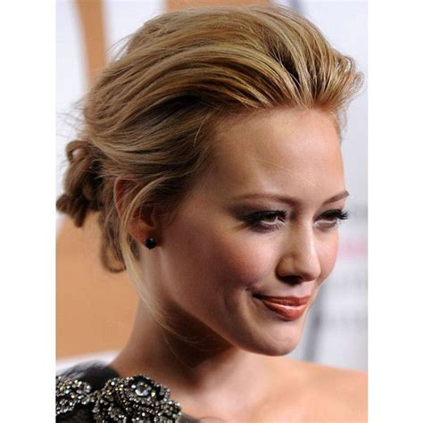 straight black hair pulled back in bun hilary duff s pulled back updo hairstyle liked on polyvore