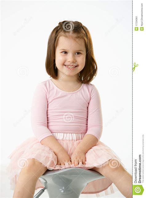 Little Girl On Chair | little girl sitting on chair stock image image 17724361