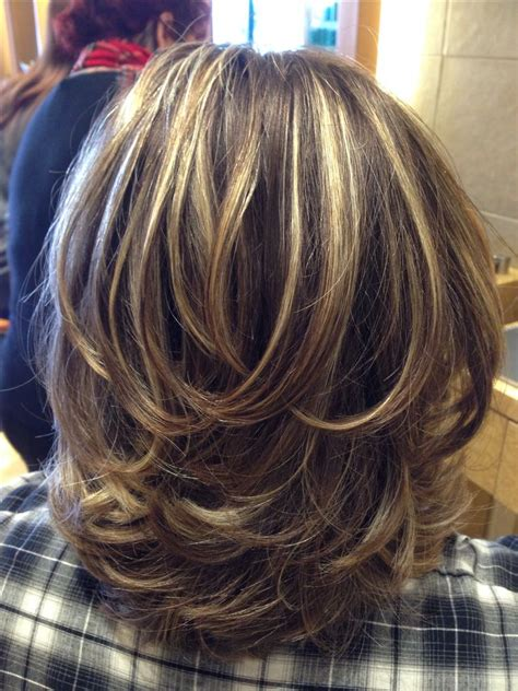 what cut layered bob and color is good to make hair look fuller shorter layers in the back gradually getting longer