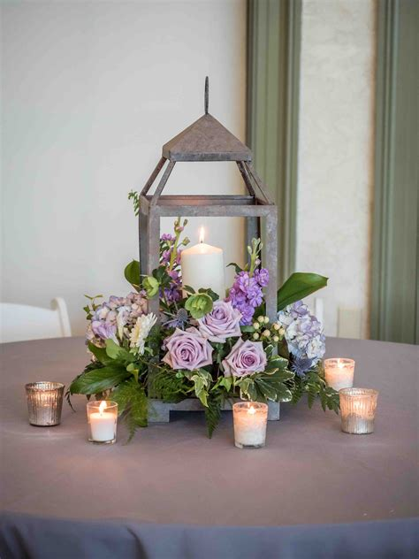 Simple And Elegant Rustic Center Piece Using A Wooden Lantern Wedding Centerpiece
