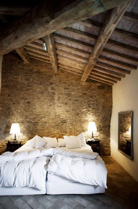 rock wall in bedroom rustic bedroom with stone wall pictures photos and