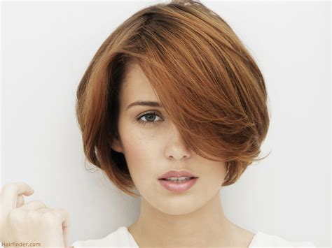 what style haircut best for women with big nose short hair with much top length for the professional woman