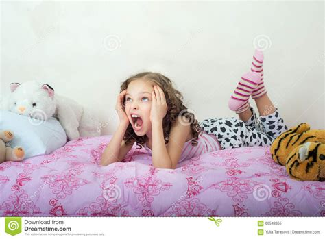 how to make a girl scream in bed screaming little girl lying on her bed stock image image